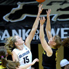 Colorado's Julie Seabrook (left) blocks a shot from Oregon's Laura Stanulis (right) during their basketball game at the University of Colorado in Boulder, Colorado March 1, 2012. CAMERA/MARK LEFFINGWELL