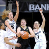 Colorado's Chucky Jeffery (left), Julie Seabrook (back left) and Lexy Kresl (right) pressure Oregon's Liz Brenner (middle right) during their basketball game at the University of Colorado in Boulder, Colorado March 1, 2012. CAMERA/MARK LEFFINGWELL