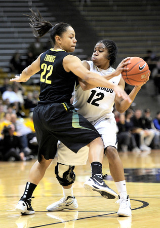 Oregon's Ariel Thomas (left) guards Colorado's Ashley Wilson (right) during their basketball game at the University of Colorado in Boulder, Colorado March 1, 2012. CAMERA/MARK LEFFINGWELL