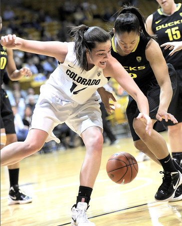 Colorado's Meagan Malcom-Peck (left) collides with Oregon's Ariel Thomas (right) going for the ball during their basketball game at the University of Colorado in Boulder, Colorado March 1, 2012. CAMERA/MARK LEFFINGWELL