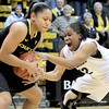 Colorado's Ashley Wilson (right) and Oregon's Ariel Thomas (left) fight for the ball during their basketball game at the University of Colorado in Boulder, Colorado March 1, 2012. CAMERA/MARK LEFFINGWELL