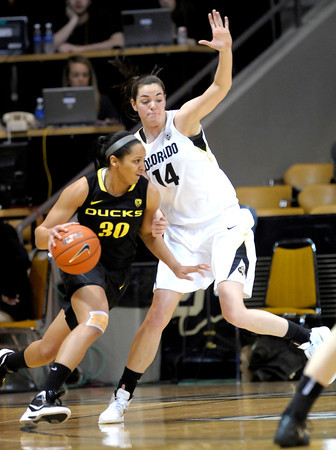 Colorado's Meagan Malcom-Peck (right) blocks Oregon's Jasmin Holliday (left) during their basketball game at the University of Colorado in Boulder, Colorado March 1, 2012. CAMERA/MARK LEFFINGWELL