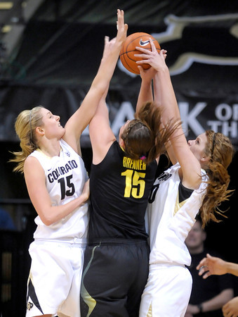 Oregon's Liz Brenner (middle) gets stopped by Colorado's Julie Seabrook (left) and Rachel Hargis (right) during their basketball game at the University of Colorado in Boulder, Colorado March 1, 2012. CAMERA/MARK LEFFINGWELL