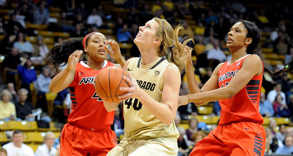 "Rachel Hargis, center, of CU drives between Carissa Crutchfield and Cheshi Poston, both of Arizona, during the first half of the January 20th, 2013 game in Boulder.<br /> For more photos of the game, go to  <a href=""http://www.dailycamera.com"">http://www.dailycamera.com</a>.<br /> Cliff Grassmick / January 20, 2013"