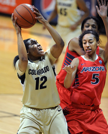 "Ashley Wilson of Colorado goes to the basket on Nyre Harris of Arizona during the second half of the January 20th, 2013 game in Boulder.<br /> For more photos of the game, go to  <a href=""http://www.dailycamera.com"">http://www.dailycamera.com</a>.<br /> Cliff Grassmick / January 20, 2013"