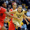 Arielle Roberson of Colorado, drives on Erica Barnes of Arizona during the first half of the January 20th, 2013 game in Boulder.<br /> <br /> Cliff Grassmick / January 20, 2013