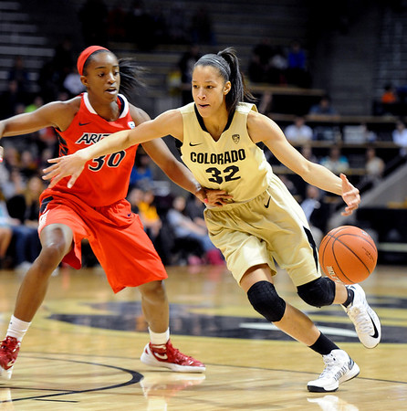 "Arielle Roberson of Colorado, drives on Alli Gloyd of Arizona, during the first half of the January 20th, 2013 game in Boulder.<br /> For more photos of the game, go to  <a href=""http://www.dailycamera.com"">http://www.dailycamera.com</a>.<br /> Cliff Grassmick / January 20, 2013"