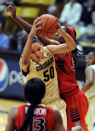 """Jamee Swan of Colorado, gets a rebound from Alli Gloyd of Arizona during the first half of the January 20th, 2013 game in Boulder.<br /> For more photos of the game, go to  <a href=""""http://www.dailycamera.com"""">http://www.dailycamera.com</a>.<br /> Cliff Grassmick / January 20, 2013"""