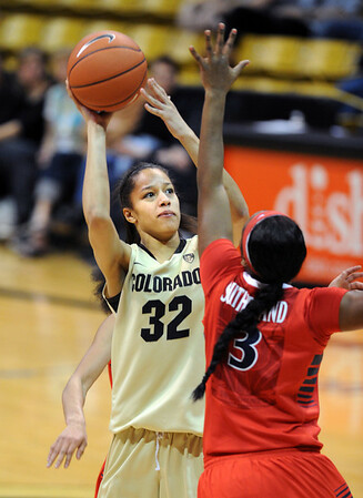 "Arielle Roberson of CU shoots over Shereen Sutherland of Arizona during the second half of the January 20th, 2013 game in Boulder.<br /> For more photos of the game, go to  <a href=""http://www.dailycamera.com"">http://www.dailycamera.com</a>.<br /> Cliff Grassmick / January 20, 2013"