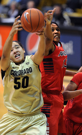 Jamee Swan of Colorado, gets a rebound from Erica Barnes of Arizona during the first half of the January 20th, 2013 game in Boulder.<br /> Cliff Grassmick / January 20, 2013