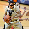 "Ashley Wilson of Colorado gets a rebound in front of Nyre Harris of Arizona during the second half of the January 20th, 2013 game in Boulder.<br /> For more photos of the game, go to  <a href=""http://www.dailycamera.com"">http://www.dailycamera.com</a>.<br /> Cliff Grassmick / January 20, 2013"