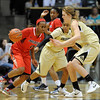 Davellyn Whyte of Arizona drives on Brittany Wilson, center, and Rachel Hargis, both of Colorado, during the first half of the January 20th, 2013 game in Boulder.<br /> Cliff Grassmick / January 20, 2013