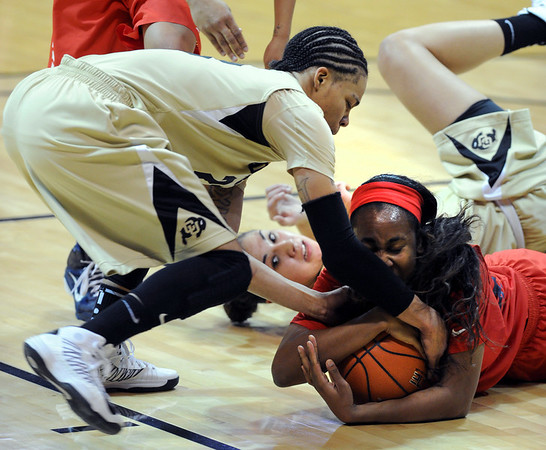 Davellyn Whyte, right, of Arizona, tries to keep the ball from Chucky Jeffery, left, and Jasmine Sborov, both of Colorado, during the first half of the January 20th, 2013 game in Boulder.<br /> Cliff Grassmick / January 20, 2013