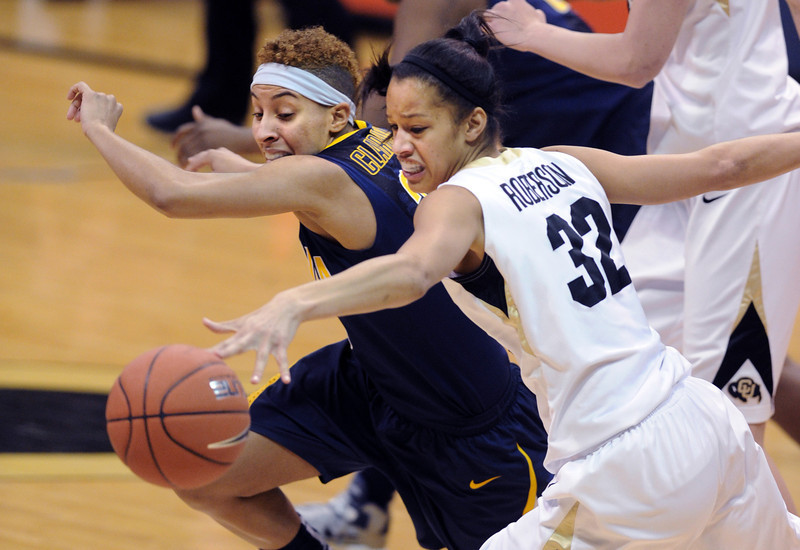 "Arielle Roberson (32) of CU, and Layshia Clarendon of Cal, chase down a ball on Sunday.<br /> For more photos of the game, go to  <a href=""http://www.dailycamera.com"">http://www.dailycamera.com</a>.<br /> Cliff Grassmick / January 6, 2013"