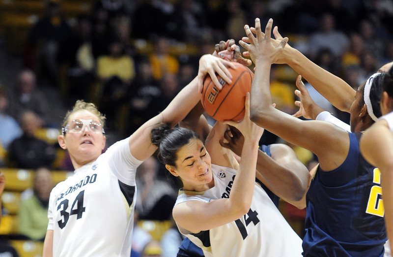 "Jen Reese, left, and Meagan Malcolm-Peck, both of CU, battle against California on Sunday.<br /> For more photos of the game, go to  <a href=""http://www.dailycamera.com"">http://www.dailycamera.com</a>.<br /> Cliff Grassmick / January 6, 2013"