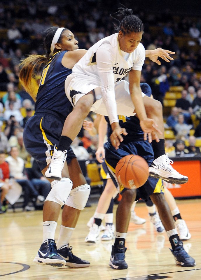 "Brittany Wilson of CU gets up in the air as Reshanda Gray of Cal defends on Sunday.<br /> For more photos of the game, go to  <a href=""http://www.dailycamera.com"">http://www.dailycamera.com</a>.<br /> Cliff Grassmick / January 6, 2013"