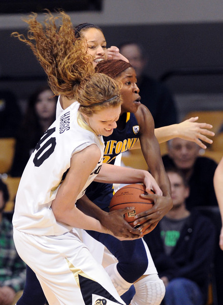 "Rachel Hargis of CU tries to rip the ball from Gennifer Brandon of Cal.<br /> For more photos of the game, go to  <a href=""http://www.dailycamera.com"">http://www.dailycamera.com</a>.<br /> Cliff Grassmick / January 6, 2013"