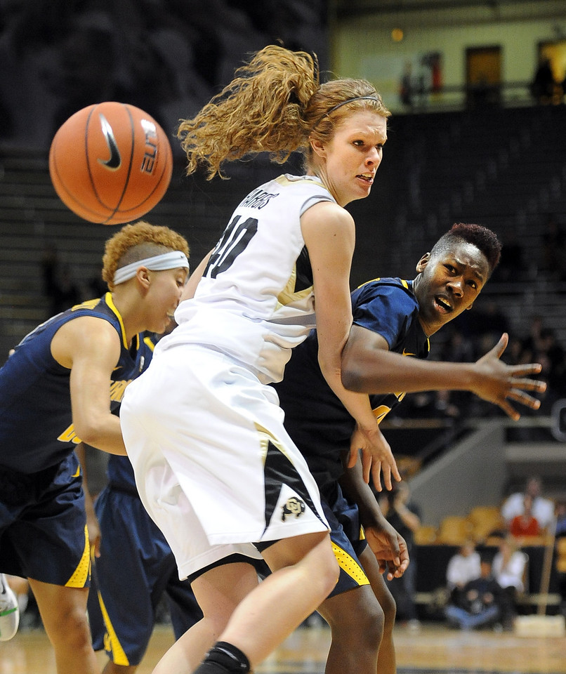 "The ball gets away from Rachel Hargis of CU and Afure Jemerigbe of Cal on Sunday.<br /> For more photos of the game, go to  <a href=""http://www.dailycamera.com"">http://www.dailycamera.com</a>.<br /> Cliff Grassmick / January 6, 2013"