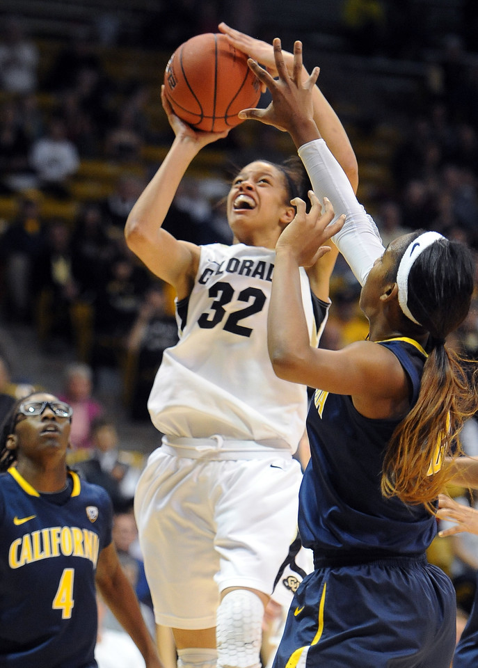 "Arielle Roberson of CU goes to basket against Cal on Sunday.<br /> For more photos of the game, go to  <a href=""http://www.dailycamera.com"">http://www.dailycamera.com</a>.<br /> Cliff Grassmick / January 6, 2013"
