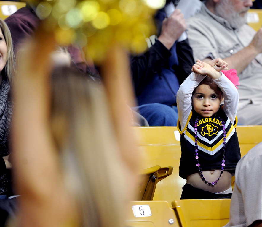 "Celia Chatterton, 3, imitates the University of Colorado cheerleaders before the women's game with California on Sunday.<br /> For more photos of the game, go to  <a href=""http://www.dailycamera.com"">http://www.dailycamera.com</a>.<br /> Cliff Grassmick / January 6, 2013"