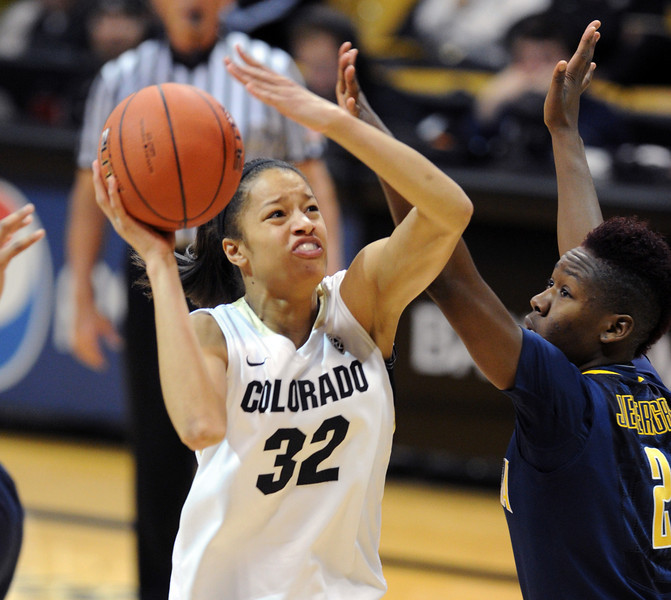"""Arielle Roberson of CU goes to the basket on Afure Jemerigbe of Cal.<br /> For more photos of the game, go to  <a href=""""http://www.dailycamera.com"""">http://www.dailycamera.com</a>.<br /> Cliff Grassmick / January 6, 2013"""