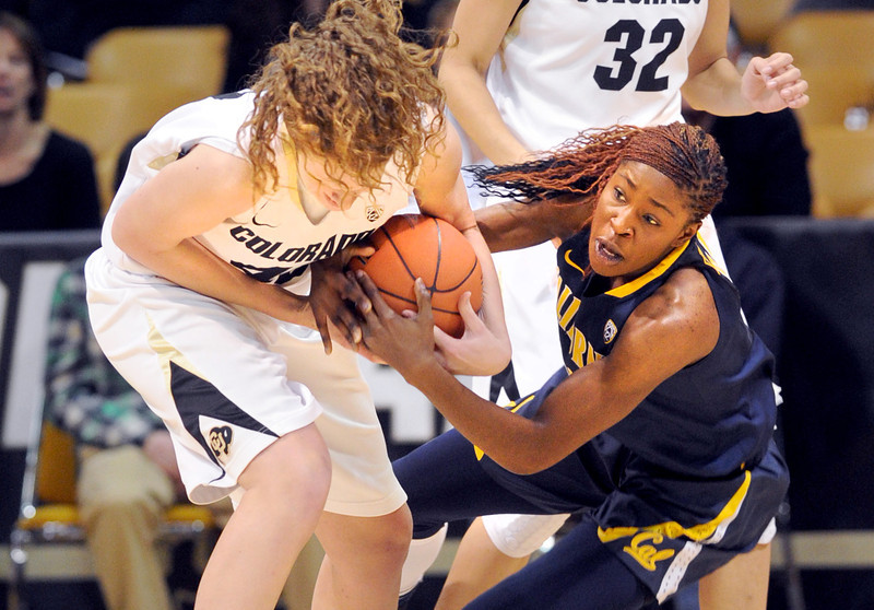 "Rachel Hargis, left,  of CU tries to rip the ball from Gennifer Brandon of Cal.<br /> For more photos of the game, go to  <a href=""http://www.dailycamera.com"">http://www.dailycamera.com</a>.<br /> Cliff Grassmick / January 6, 2013"