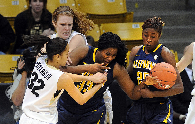 "Arielle Roberson (32) and Rachel Hargis, both of CU, defend Talia Caldwell of Cal.<br /> For more photos of the game, go to  <a href=""http://www.dailycamera.com"">http://www.dailycamera.com</a>.<br /> Cliff Grassmick / January 6, 2013"