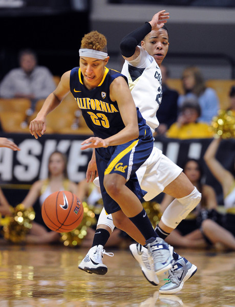 "Layshia Clarendon of Cal, spins around Chucky Jeffery of CU during the first half of the game Sunday.<br /> For more photos of the game, go to  <a href=""http://www.dailycamera.com"">http://www.dailycamera.com</a>.<br /> Cliff Grassmick / January 6, 2013"