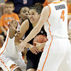 Oklahoma State's Toni Young(left) and Liz Donohoe pressure Jasmine Sborov of  Colorado during their basketball game in the Women's NIT March 25, 2012. MIKE SIMONS/Tulsa World