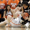 Oklahoma State's Jordan Shultz battles for posession of a ball against Ashley Wilson of Colorado during their basketball game in the Women's NIT March 25, 2012. MIKE SIMONS/Tulsa World