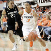 Oklahoma State's Tiffany Bias drives the ball under pressure from Chucky Jeffery of  Colorado during their basketball game in the Women's NIT March 25, 2012. MIKE SIMONS/Tulsa World