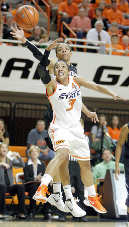 Oklahoma State's Tiffany Bias battles for posession against Chucky Jeffery of Colorado during their basketball game in the Women's NIT March 25, 2012. MIKE SIMONS/Tulsa World
