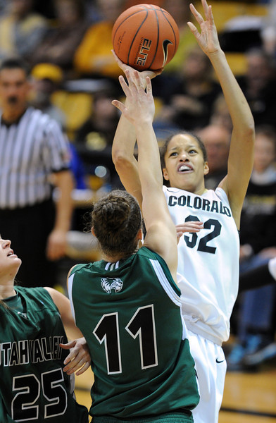 Arielle Roberson of CU shoots over Sammie Jensen of Utah Valley during the second half of the December 22, 2012 game in Boulder.<br /> Cliff Grassmick / December 22, 2012