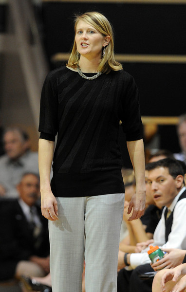 CU coach, Linda Lappe, talks to her team during the first half of the December 22, 2012 game in Boulder.<br /> Cliff Grassmick / December 22, 2012