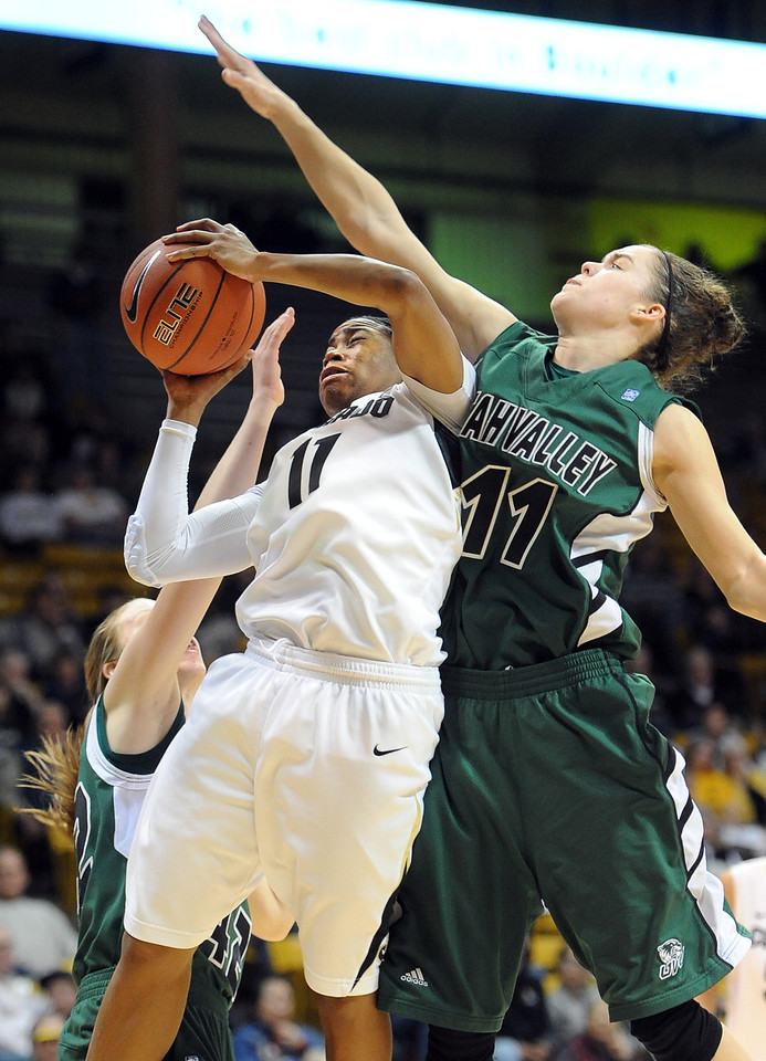Brittany Wilson of CU  goes to the basket on Sammie Jensen of Utah Valley during the first half of the December 22, 2012 game in Boulder.<br /> Cliff Grassmick / December 22, 2012