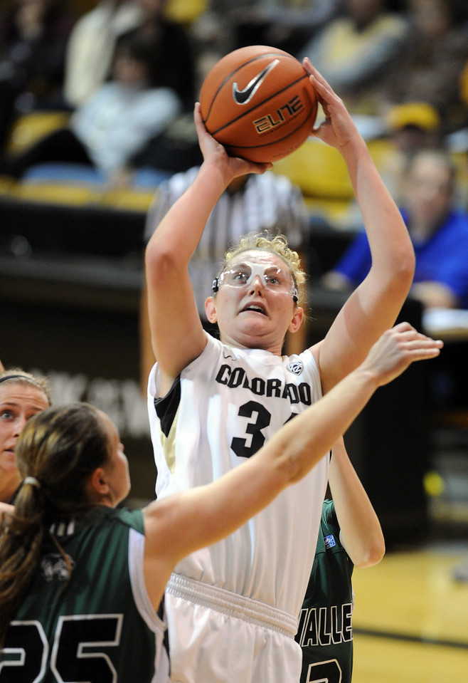 Jen Reese of CU fires up a shot against Kaycee Mansfield of Utah Valley during the second half of the December 22, 2012 game in Boulder.<br /> Cliff Grassmick / December 22, 2012