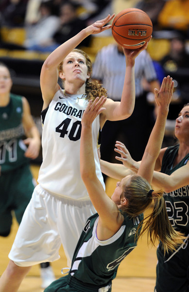 Rachel Hargis of Colorado shoots over Alle Finch Cardwell of Utah Valley during the second half of the December 22, 2012 game in Boulder.<br /> Cliff Grassmick / December 22, 2012