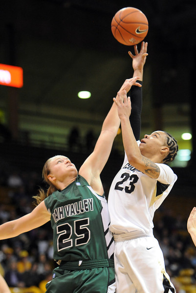 Chucky Jeffery of CU puts up a shot on Kaycee Mansfield of Utah Valley during the first half of the December 22, 2012 game in Boulder.<br /> Cliff Grassmick / December 22, 2012