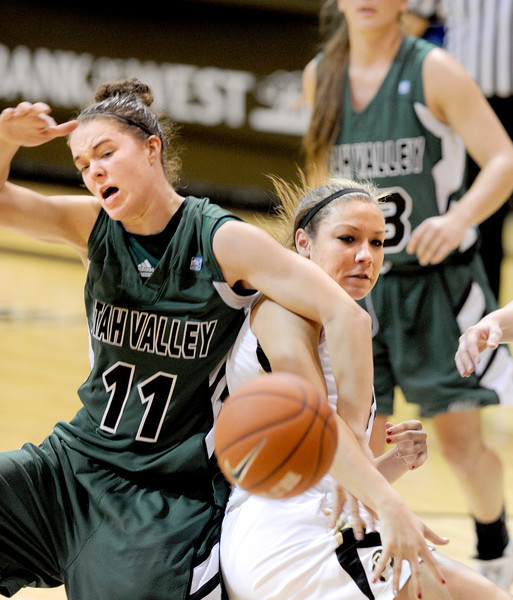 Sammie Jensen (11) of Utah Valley and Alexus Atchley of CU, battle under the boards during the second half of the December 22, 2012 game in Boulder.<br /> Cliff Grassmick / December 22, 2012