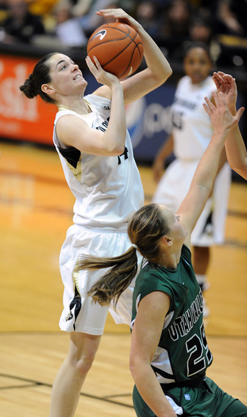 Meagan Malcolm-Peck of CU shoots over Kaycee Mansfield of Utah Valley during the second half of the December 22, 2012 game in Boulder.<br /> Cliff Grassmick / December 22, 2012