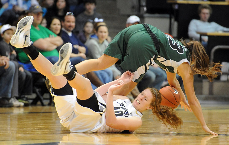 Rachel Hargis of CU is run over by Whitney Jenkins of Utah Valley during the first half of the December 22, 2012 game in Boulder.<br /> Cliff Grassmick / December 22, 2012