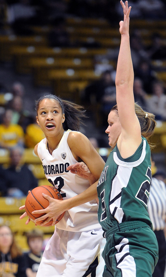 Arielle Roberson of CU looks to score on Kaycee Mansfield of Utah Valley during the first half of the December 22, 2012 game in Boulder.<br /> Cliff Grassmick / December 22, 2012
