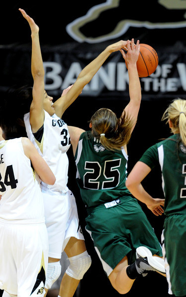 Arielle Roberson of CU blocks the shot of Kaycee Mansfield of Utah Valley during the first half of the December 22, 2012 game in Boulder.<br /> Cliff Grassmick / December 22, 2012