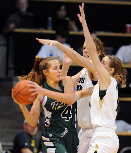 Alle Finch Cardwell of Utah Valley is trapped by Rachel Hargis and Lexy Kresl of CU during the first half of the December 22, 2012 game in Boulder.<br /> Cliff Grassmick / December 22, 2012