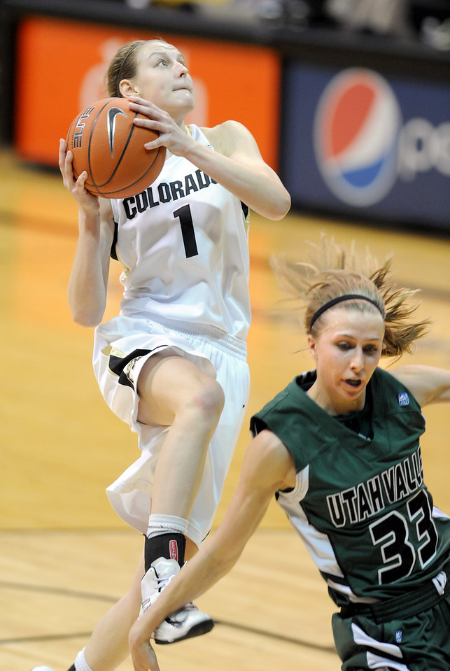 Lezy Kresl of Colorado drives on Whitney Jenkins of Utah Valley during the second half of the December 22, 2012 game in Boulder.<br /> Cliff Grassmick / December 22, 2012