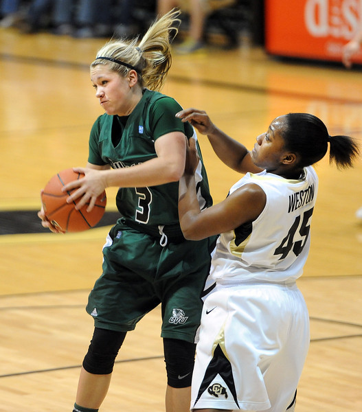 Cynde Gray of Utah Valley gets a rebound in front of Kyleesha Weston of Colorado during the first half of the December 22, 2012 game in Boulder.<br /> Cliff Grassmick / December 22, 2012