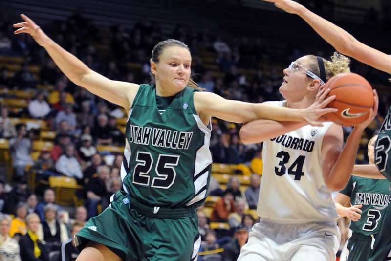 Kaycee Mansfield (25) of Utah Valley, tries to stop Jen Reese, of Colorado, from shooting during the first half of the December 22, 2012 game in Boulder.<br /> Cliff Grassmick / December 22, 2012