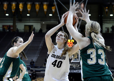 University of Colorado's Rachel Hargis takes a shot over Caitlin Duffy, No. 33, during a game against Colorado State University on Wednesday, Dec. 5, at the Coors Event Center on the CU campus in Boulder. For more photos of the game go to www.dailycamera.com Jeremy Papasso/ Camera