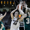 "University of Colorado's Rachel Hargis takes a shot over Caitlin Duffy, No. 33, during a game against Colorado State University on Wednesday, Dec. 5, at the Coors Event Center on the CU campus in Boulder. For more photos of the game go to  <a href=""http://www.dailycamera.com"">http://www.dailycamera.com</a><br /> Jeremy Papasso/ Camera"