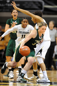 Caitlin Duffy of CSU, tries to move by Arielle Roberson of CU  on Wednesday night. For more photos from CU CSU basketball, go to www.dailycamera.com. Cliff Grassmick / December 5, 2012